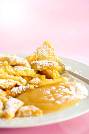 Austrian sweet dessert called kaiserschmarrn with apple sauce