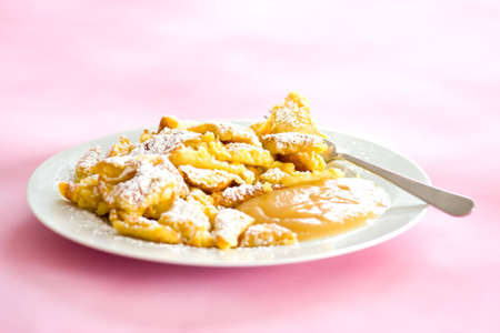 Austrian sweet dessert called kaiserschmarrn with apple sauce