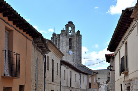 Street and bell tower of the church in Montealegre de Campos, Valladolid, Spain