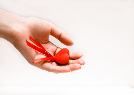 red heart in the female hand