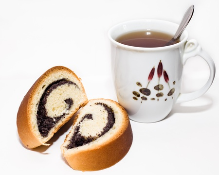 Rolled biscuit with poppy and a cup of tea