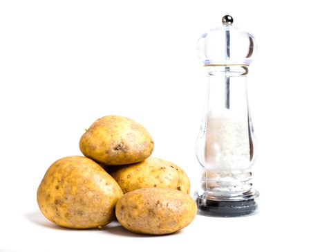 New potatoes and salt shaker isolated on white background
