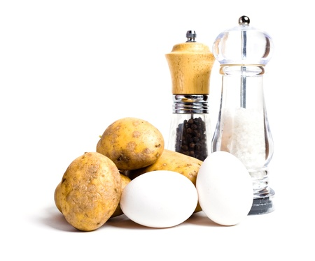 New potatoes, eggs and salt and pepper shakers isolated on white background