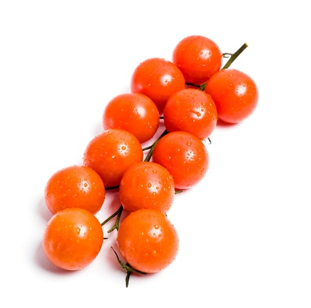 Red cherry tomatoes isolated on white background photo