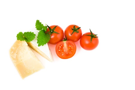 french cheese brie and parmesan with cherry tomatoes on white background Stock Photo