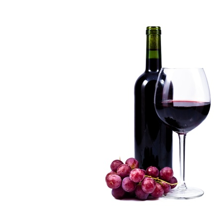 wine glass with red wine, bottle of wine and grapes isolated over white background