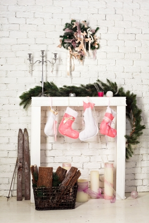 imitation of christmas firewood with socks Stock Photo - 16885925