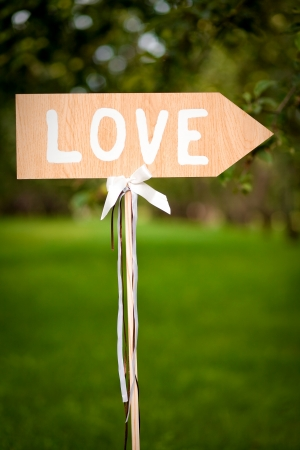 sign showing direction to love