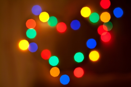Abstract circular bokeh in the form of heart of christmas lights for background