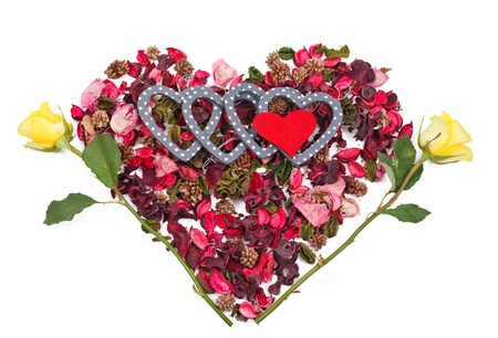 heart shaped stuff: five hearts in the background of petals in the form of a heart over white Stock Photo