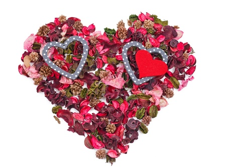 three hearts in the background of petals in the form of a heart over white Stock Photo - 17596552