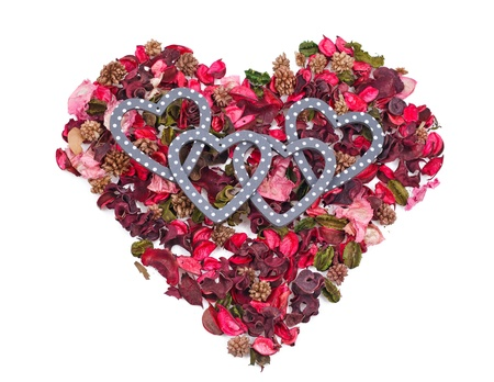 four hearts in the background of petals in the form of a heart over white Stock Photo - 17596551