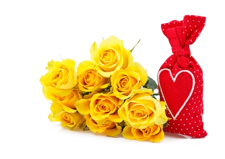 red sachet bag with a heart and yellow roses isolated over white