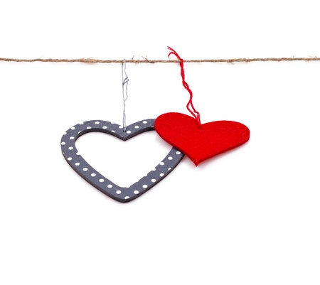 heart shaped stuff: two hearts hung up on the string isolated over white Stock Photo