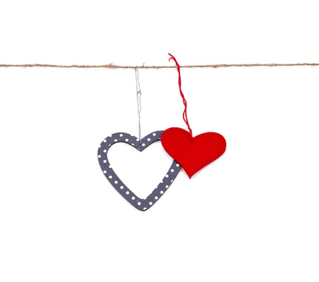 two hearts hung up on the string isolated over white Stock Photo - 17596568