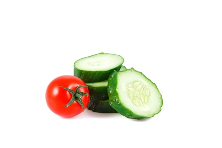 fresh green cucumber and tomato isolated over white background