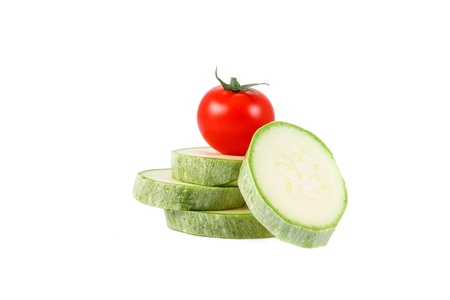fresh green marrow and tomato isolated over white background