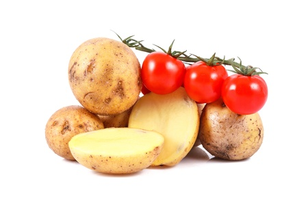 fresh potatoes and tomatoes isolated over white background