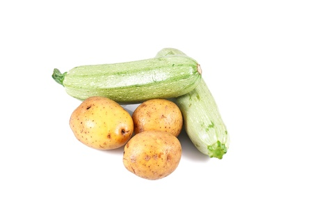 a group of fresh potatoes and marrow isolated on white background