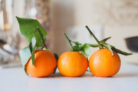 three fresh juicy tangerines Stock Photo