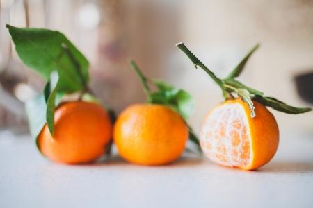 three fresh juicy tangerines Stock Photo