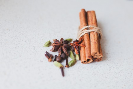 cinnamon sticks and spices on the kitchen table
