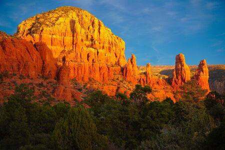 Winter Sunset highlights the colors on the Red Rocks of Sedona, Arizona. Stock Photo