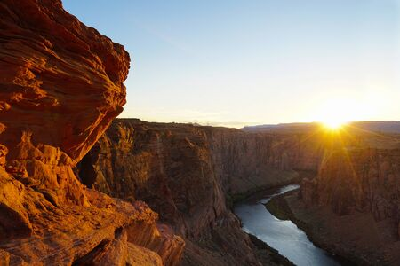 The dramatic colors of sunset over Glen Canyon. Banco de Imagens