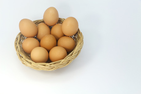 Many eggs in the basket isolated on white background. Stock Photo