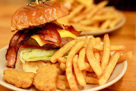 Traditional american burger, Freshly french fries and chicken nuggets photo