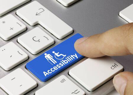Accessibility Written on Blue Key of Metallic Keyboard. Finger pressing key.