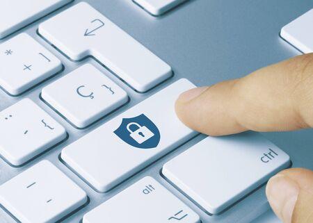 Security Written on Blue Key of Metallic Keyboard. Finger pressing key.