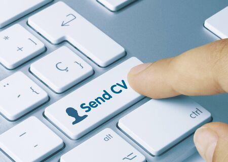 Send CV Written on White Key of Metallic Keyboard. Finger pressing key