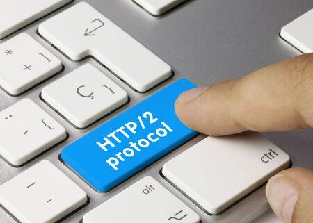 HTTP 2 protocol Written on Blue Key of Metallic Keyboard. Finger pressing key.