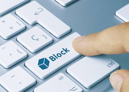 Block Written on Blue Key of Metallic Keyboard. Finger pressing key