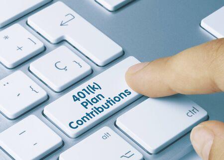 401(k) Plan Contributions Written on Blue Key of Metallic Keyboard. Finger pressing key