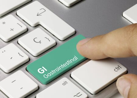 GI Gastrointestinal Written on Green Key of Metallic Keyboard. Finger pressing key.