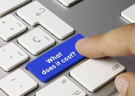 What does it cost? Written on Blue Key of Metallic Keyboard. Finger pressing key. Stock fotó