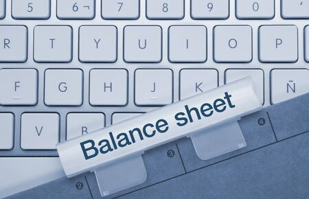 Balance Sheet Written on Blue Key of Metallic Keyboard. Finger pressing key.