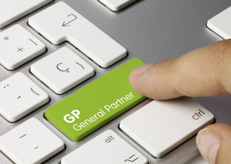GP General partner Written on Green Key of Metallic Keyboard. Finger pressing key.
