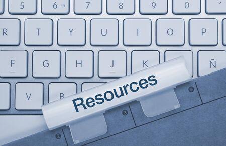 Resources  Written on Blue Key of Metallic Keyboard. Finger pressing key.