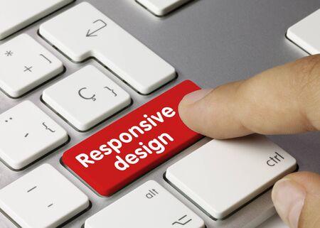 Responsive design Written on Red Key of Metallic Keyboard. Finger pressing key. Archivio Fotografico