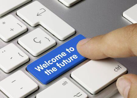 Welcome to the future Written on Blue Key of Metallic Keyboard. Finger pressing key.