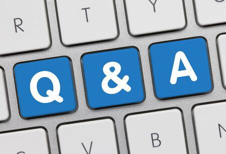 Questions and Answers  Written on Blue Key of Metallic Keyboard. Finger pressing key.
