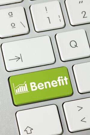Benefit Written on Green Key of Metallic Keyboard. Finger pressing key. Foto de archivo - 150385588