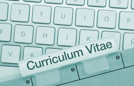 Curriculum Vitae Written on Blue Key of Metallic Keyboard. Finger pressing key.
