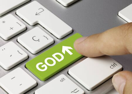 GOD Written on Green Key of Metallic Keyboard. Finger pressing key. Stok Fotoğraf