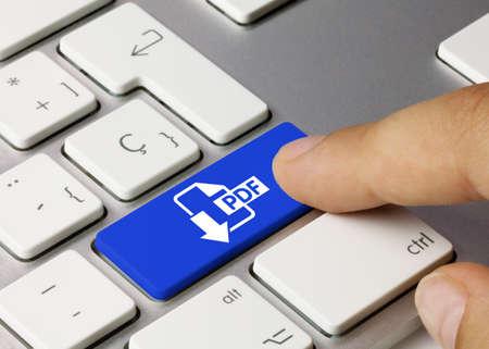 Download PDF Written on Blue Key of Metallic Keyboard. Finger pressing key.