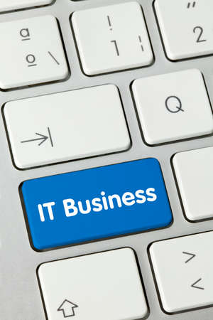 IT Business Written on Blue Key of Metallic Keyboard. Finger pressing key.