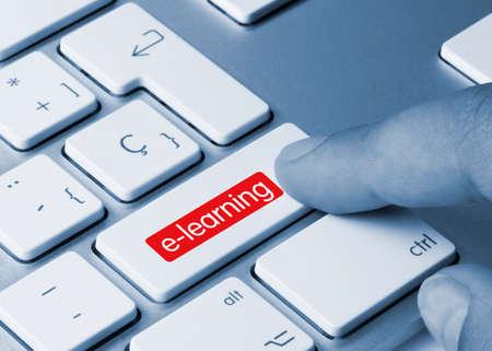 e-learning Written on Blue Key of Metallic Keyboard. Finger pressing key.